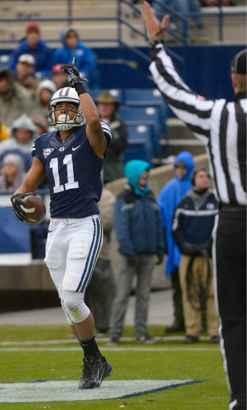 Leah Hogsten  |  The Salt Lake Tribune Brigham Young Cougars wide receiver Terenn Houk (11) catches a 9yd pass for a touchdown in the first half. Brigham Young University leads Savannah State 51-0 at the half, November 22, 2014, at LaVell Edwards Stadium in Provo.