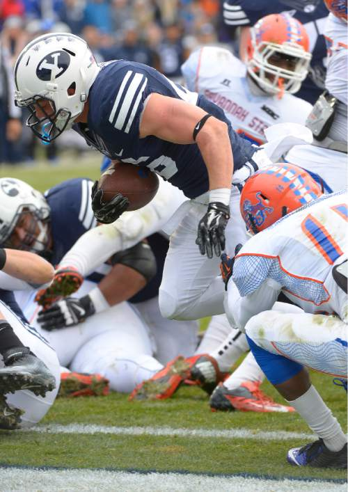 Leah Hogsten     The Salt Lake Tribune Brigham Young Cougars running back Nate Carter (26) slips over the goal for his first half touchdown. Brigham Young University leads Savannah State 51-0 at the half, November 22, 2014, at LaVell Edwards Stadium in Provo.