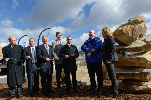 """Francisco Kjolseth     The Salt Lake Tribune Sandy officials, including Mayor Tom Dolan, second from right, hold a """"climbing rope"""" cutting event at the site of the future Prestige, a 25-story high-rise residential building in the heart of a new 1,100 acre city center called """"The Cairns."""" The project from 90th S. to 114th S., and I-15 to UTA light rail calls for 20 million square feet of development."""
