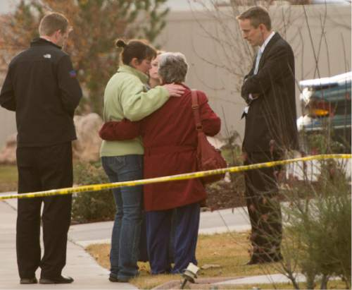 Rick Egan  |  The Salt Lake Tribune  Neighbors and loved ones gather as the police investigate a fatal accidental shooting in the 1900 block of Cooper Street in Kaysville, Sunday, November 23, 2014