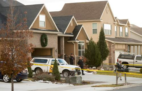 Rick Egan  |  The Salt Lake Tribune  Police investigate a fatal accidental shooting in the 1900 block of Cooper Street in Kaysville, Sunday, November 23, 2014