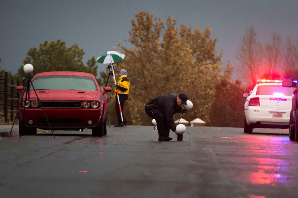 Rick Egan  |  The Salt Lake Tribune  Investigators on the scene of a shooting in South Jordan on Brook North Lance Lane, Saturday, November 22, 2014