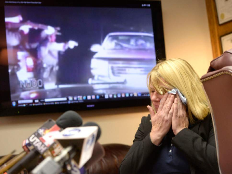 Al Hartmann  |  The Salt Lake Tribune Kristine Biggs Johnson breaks down as her attorney Bob Sykes, plays a Youtube video from a law enforcement dashcam when she was shot in the eye November 2012.  Her attorney Bob Sykes is filing a federal civil rights lawsuit Thursday November 13 against a Morgan County Sheriffís deputy for improper use of deadly force against her. The shooting was deemed unjustified by Davis County Attorney Troy Rawlings, but no charges were filed against the deputy.
