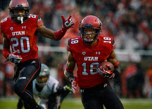 Scott Sommerdorf   |  The Salt Lake Tribune Utah DB Eric Rowe glides into the end zone with an interception to give Utah a very quick 7-0 lead. Utah took a 21-0 lead over Washington State in the first quarter, Saturday, September 27, 2014. Team mate Marcus Williams celebtrates at left.