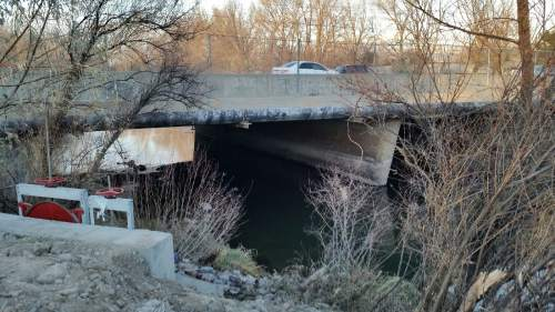 Lennie Mahler | The Salt Lake Tribune  West Valley City police discovered a body of unknown age and gender in the Jordan River on Monday Dec. 1, 2014.