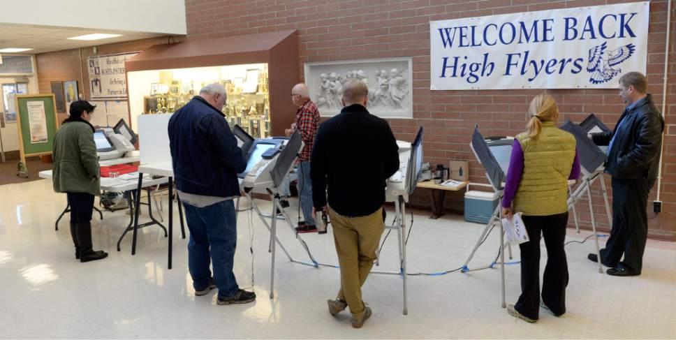 Al Hartmann  |  The Salt Lake Tribune Voting booths were full in early morning voting at precinct SLC 108 at Hawthorne Elementary School in Salt Lake City Tuesday November 4.