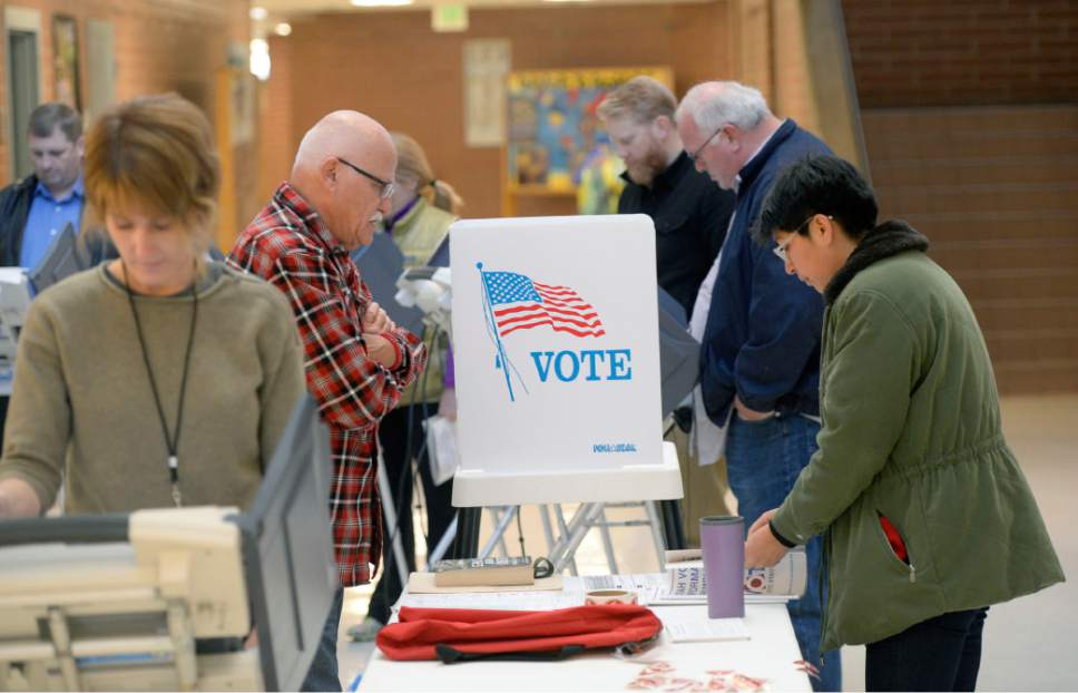 Al Hartmann  |  Tribune file photo The state is trying to figure out the methods Utahns will use to vote in the future. The decision could affect how many voting machines need to be replaced and have a big impact on the cost.