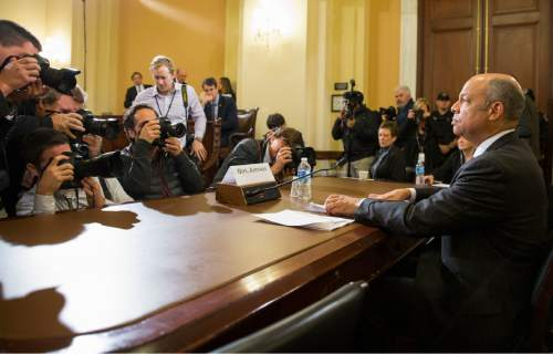 Homeland Security Secretary Jeh Johnson prepares to testify on Capitol Hill in Washington, Tuesday, Dec. 2, 2014, before a House Homeland Security Committee hearing on the impact of President Barack Obama's executive action on immigration. (AP Photo/Evan Vucci)