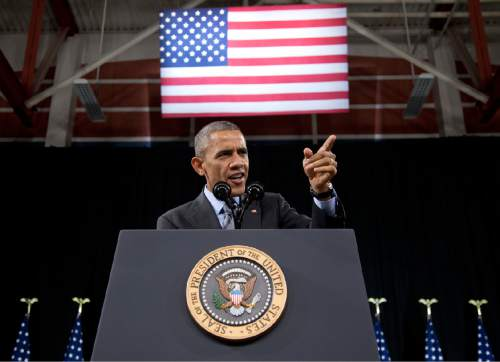 President Barack Obama speaks about immigration at Del Sol High School, in Las Vegas, Friday, Nov. 21, 2014. The president unveiled expansive executive actions on immigration Thursday night to spare nearly 5 million people in the U.S. illegally from deportation, setting off a fierce fight with Republicans over the limits of presidential powers. (AP Photo/Carolyn Kaster)