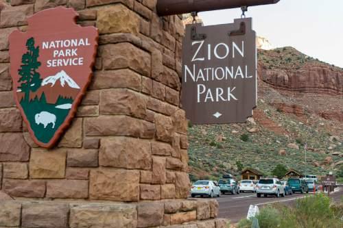 Trent Nelson  |  The Salt Lake Tribune Visitors lines up to get into Zion National Park, Thursday September 25, 2014.