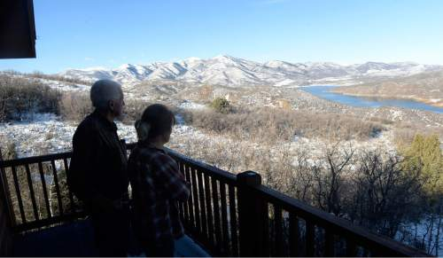 Al Hartmann  |  The Salt Lake Tribune Ray and Joan Cummings look from the balcony of their cabin on the mountainside overlooking Jordanelle Reservoir near. Much of the Cummings family's sprawling property has been lost in a dispute with the Jordanelle Special Service District. The family is among other landowners who blame the district for massive debt, high fees and foreclosures amid allegations of mismanagement and, possibly, corruption.