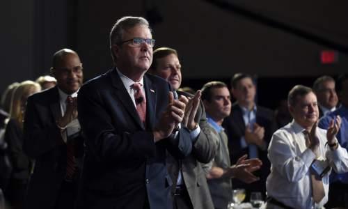 Former Florida Gov. Jeb Bush applauds a speaker before giving his keynote address at the National Summit on Education Reform in Washington, Thursday, Nov. 20, 2014. (AP Photo/Susan Walsh)
