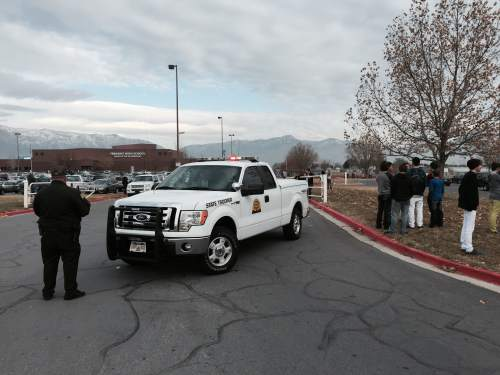 Francisco Kjolseth | The Salt Lake Tribune  Police and students stand outside Fremont High School near Ogden after a student who allegedly had a gun was arrested on Monday Dec. 1, 2014.