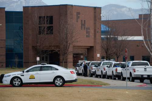 Francisco Kjolseth  |  The Salt Lake Tribune Fremont High school in Plain City is locked down after reports of a student seen with a gun on Monday, Dec. 1, 2014.