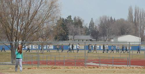 Francisco Kjolseth  |  The Salt Lake Tribune Students file out of Fremont High school in Plain City during a lock down after reports of a student seen with a gun on Monday, Dec. 1, 2014.
