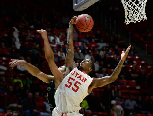 Utah guard Delon Wright (55) grabs a rebound during the second half on an NCAA college basketball game, Friday, Nov. 28, 2014 in Salt Lake City. (AP Photo/The Salt Lake Tribune, Scott Sommerdorf)  DESERET NEWS OUT; LOCAL TELEVISION OUT; MAGS OUT