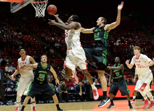 Utah guard Delon Wright (55) drives to score against North Dakota forward Chad Calcaterra (33) during the first half on an NCAA college basketball game, Friday, Nov. 28, 2014 in Salt Lake City. (AP Photo/The Salt Lake Tribune, Scott Sommerdorf)  DESERET NEWS OUT; LOCAL TELEVISION OUT; MAGS OUT