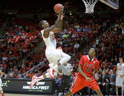 Utah's Delon Wright (55) goes to the basket as Ball State's Jeremie Tyler (22) watches during the second half during an NCAA college basketball game Friday, Nov. 14, 2014, in Salt Lake City. Utah won 90-72. (AP Photo/Rick Bowmer)