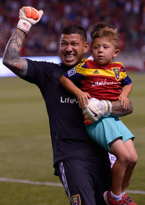 Leah Hogsten     The Salt Lake Tribune Real Salt Lake goalkeeper Nick Rimando (18) celebrates his new MLS record for career game shutouts at 113 with his son Jet.  Real Salt Lake defeated D. C. United 3-0 Saturday, August 9, 2014, at Rio Tinto Stadium.