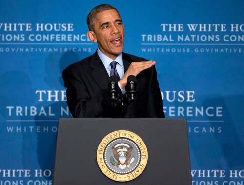 President Barack Obama speaks during the 2014 White House Tribal Nations Conference at the Capital Hilton in Washington, Wednesday, Dec. 3, 2014, to announce an initiative aimed at improving conditions and opportunities for American Indian youth, more than a third of whom live in poverty. The president also spoke about a grand jury that cleared a white New York City police officer in the videotaped chokehold death of an unarmed black man who had been stopped on suspicion of selling loose, untaxed cigarettes. The decision not to indict Officer Daniel Pantaleo threatened to add to the tensions that have simmered in the city since the July 17 death of Eric Garner (AP Photo/Carolyn Kaster)