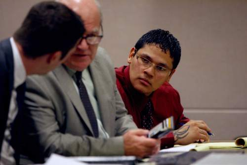Jesse Anthony Saenz, far right, listens as his defense attorneys talk to each other during the jury selection phase of his murder trial Monday, Aug. 18, 2014. Saenz, 24, is accused of killing 22-year-old Elvis Zachary Olsen in April 2013. An apparent motive for the killing has never been released.