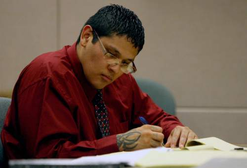 Jesse Anthony Saenz takes notes during the jury selection phase of his murder trial Monday, Aug. 18, 2014. Saenz, 24, is accused of killing 22-year-old Elvis Zachary Olsen in April 2013. An apparent motive for the killing has never been released.