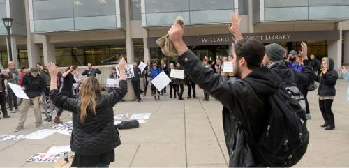 Al Hartmann  |  The Salt Lake Tribune About 75 University of Utah students rallied in support of Michael Brown and Ferguson protesters at the Marriott Library plaza Monday Dec. 1, 2014. The protest was largely organized via Twitter using the hashtag handsupwalkout. This was part of a nationwide protest.