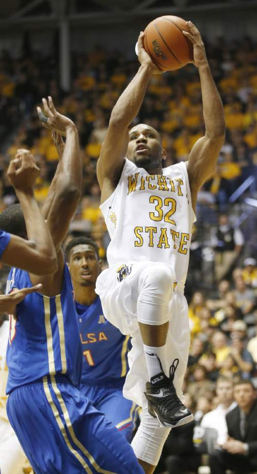 Wichita State's Tekele Cotton shoots over Tulsa in the second half of an NCAA college basketball game on Saturday, Nov. 29, 2014, in Wichita, Kan. WSU won 75-55. (AP Photo/The Wichita Eagle, Jaime Green)