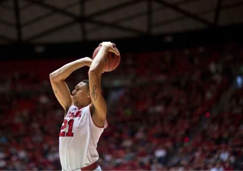 Lennie Mahler  |  The Salt Lake Tribune Utah's Jordan Loveridge shoots a corner three pointer in the first half of a game at the Huntsman Center, Saturday, March 1, 2014.