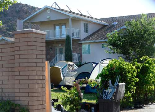 Scott Sommerdorf   |  The Salt Lake Tribune A house on Homestead Street in Hildale had a number of tents set up in the yard. Later, a meeting was held at Mohave Community College in Colorado City to discuss the UEP distribution, Saturday, August 9, 2014.