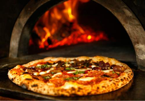 A Quattro Stagione Pizza Fresh Out Of The Wood Fired Brick Oven At Settebello S