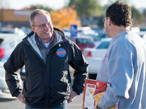 Rick Egan  | Tribune file photo  Congressional candidate Doug Owens visits with Patrick McLaughlin as he campaigned in the election's final hours. He lost a close race to Republican Mia Love but says he would 'definitely consider' another run.