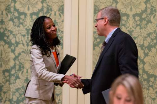 Trent Nelson  |  Tribune file photo Utah 4th Congressional District Candidates Mia Love and Doug Owens shake hands before their first debate last year. The two will face each other again in next year's election and the money is already flowing.