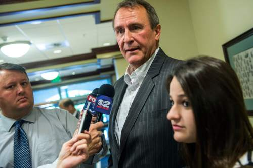 Chris Detrick  |  The Salt Lake Tribune Former Attorney General Mark Shurtleff and his daughter Annie talk to members of the media after a committee hearing at the State Capitol Wednesday June 18, 2014.