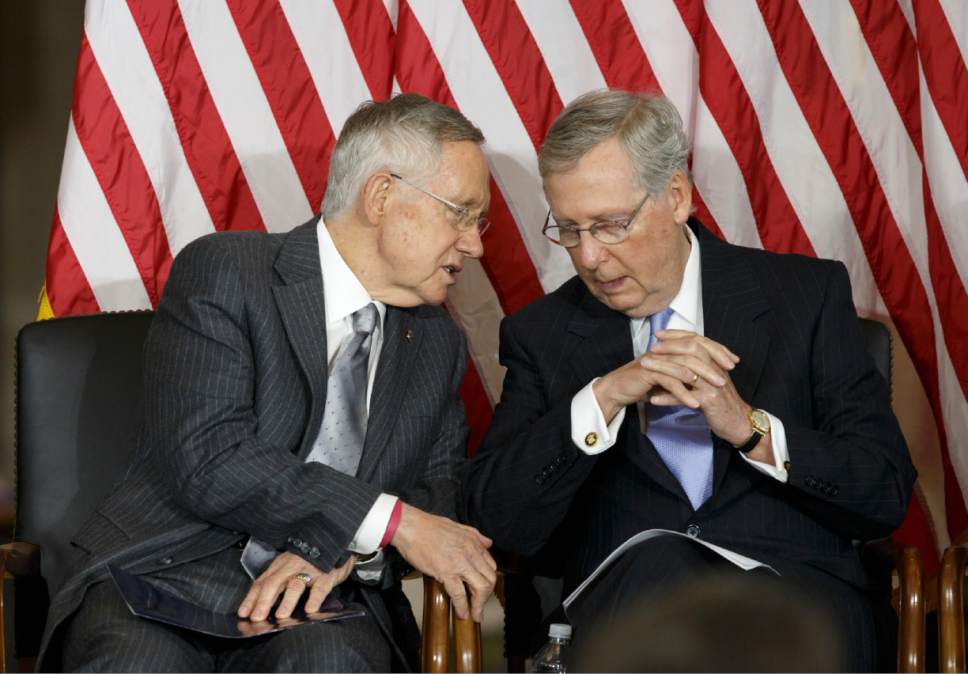 "Senate Majority Leader Harry Reid, D-Nev., left, and Senate Minority Leader Mitch McConnell, R-Ky., sit together as Congress honors victims of the terror attacks of September 11, 2001, during a ""Fallen Heroes of 9/11 Gold Medal Ceremony"" at the Capitol in Washington, Wednesday, Sept. 10, 2014.  (AP Photo/J. Scott Applewhite)"