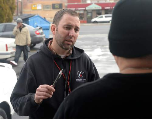 Al Hartmann  |  The Salt Lake Tribune Phil Taylor, nurse practitioner for the Fourth Street Clinic talks to homeless man on State Street in Salt Lake City Wednesday December 4.  He operates the clinic's mobile medical van but much of his work is talking to homeless, earning their trust and explaining the medical services provided by the clinic.