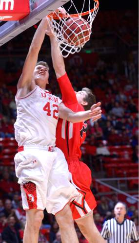 Leah Hogsten  |  The Salt Lake Tribune Utah Utes forward Jakob Poeltl (42) dunks against Ball State during the first half of the Utes' home opener at the Jon M. Huntsman Center in Salt Lake City, November 14, 2014.