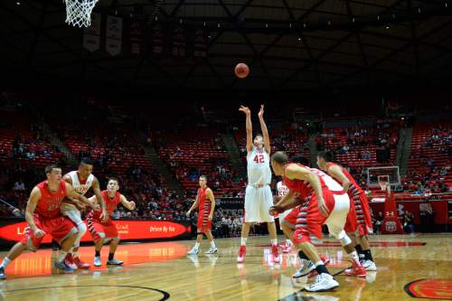 Chris Detrick  |  The Salt Lake Tribune Utah Utes forward Jakob Poeltl (42) shoots a free throw during the game at the Huntsman Center Thursday November 6, 2014.