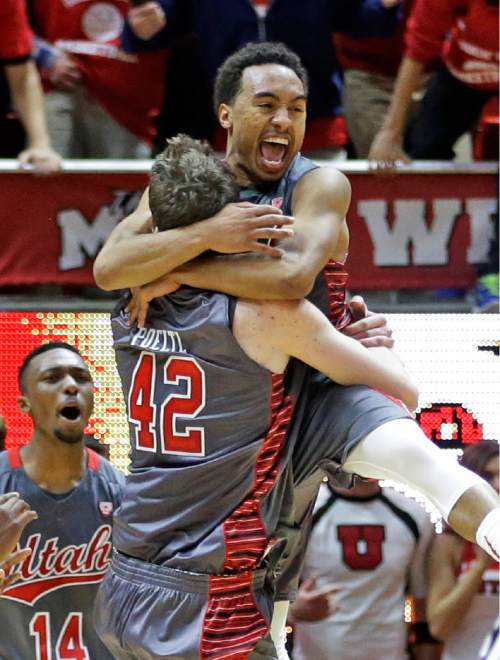 Utah guard Brandon Taylor, right, celebrates with forward Jakob Poeltl (42) following an NCAA college basketball game against Wichita State, Wednesday, Dec. 3, 2014, in Salt Lake City. Utah won 69-68 in overtime. (AP Photo/Rick Bowmer)