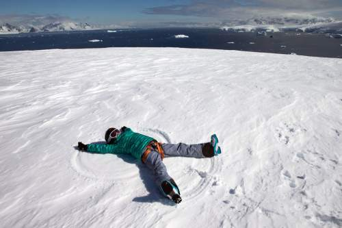 Lilliana Libecki, 11, found time to make a snow angel while visiting Antarctica with her father, Mike Libecki, in November. The father and daughter from Salt Lake City skied among penguins while visiting the South Pole.  photos courtesy Mike Schirf