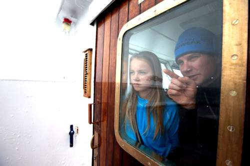 Mike Libecki and his daughter Lilliana, 11, take in the scenery of Antarctica from a boat during a trip in November. The Libeckis live in Salt Lake City. photos courtesy Mike Schirf