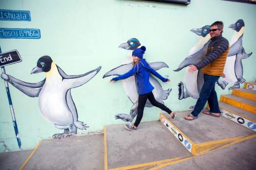 Lilliana and Mike Libecki of Salt Lake City walk amongst the penguins in Argentina before getting on a boat to visit real penguins in Antarctica. photos courtesy Mike Schirf