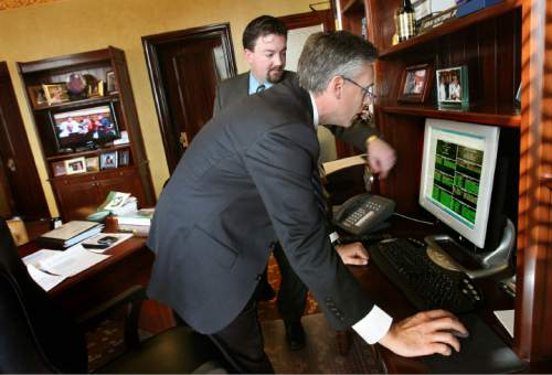 Tribune file photo Then- Utah Gov.  Jon Huntsman at the progress of bills with Neil Ashdown, his chief of staff, in this 2008 photo. Ashdown was a top aide to Huntsman when he went to Beijing as U.S. ambassador to China. Ashdown now works on the Huntsman presidential campaign.