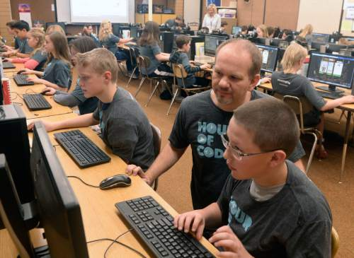 Al Hartmann  |  The Salt Lake Tribune Pluralsight instructor-author Joe Eames gives helps sixth-graders at Layton Elementary School get an introduction to computer programing during the annual Pluralsight Hour of Code event on Tuesday.