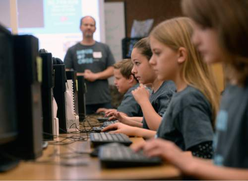 Al Hartmann  |  The Salt Lake Tribune Sixth-graders at Layton Elementary School get an introduction to computer programing during the annual Pluralsight Hour of Code event Tuesday Dec. 9, 2014.