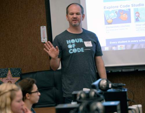 Al Hartmann  |  The Salt Lake Tribune Sixth-graders at Layton Elementary School get an introduction to computer programing during the annual Pluralsight Hour of Code event Tuesday Dec. 9, 2014. Pluralsight instructor-author Joe Eames starts the coding class.