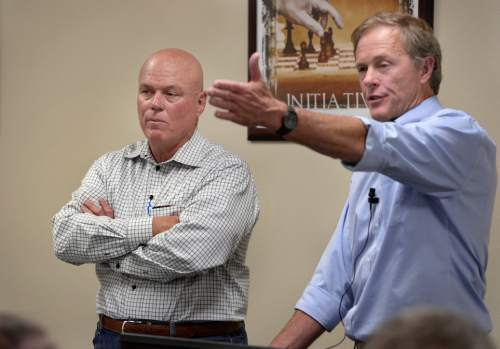 Scott Sommerdorf   |  The Salt Lake Tribune UEP attorney Jeff Shields speaks at a meeting held at Mohave Community College in Colorado City to discuss the UEP distribution. UEP fiduciary Bruce Wisan is at left, Saturday, August 9, 2014.