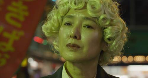 """A blonde wig gives a Tokyo office lady (Kaori Momoi) a new identity in Atsuko Hirayanagi's short film """"Oh Lucy!,"""" one of the 60 short films chosen for the 2015 Sundance Film Festival. Courtesy Sundance Film Festival"""