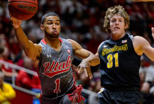 Trent Nelson  |  The Salt Lake Tribune Utah Utes guard Isaiah Wright (1) passes the ball, defended by Wichita State Shockers guard Ron Baker (31) as the University of Utah Utes host the Wichita State Shockers, college basketball at the Huntsman Center in Salt Lake City, Wednesday December 3, 2014.