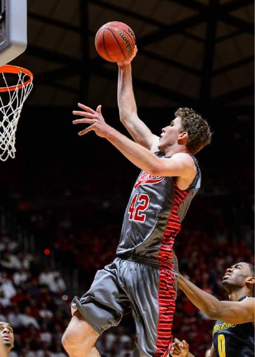 Trent Nelson  |  The Salt Lake Tribune Utah Utes forward Jakob Poeltl (42) goes up for a dunk as the University of Utah Utes host the Wichita State Shockers, college basketball at the Huntsman Center in Salt Lake City, Wednesday December 3, 2014.